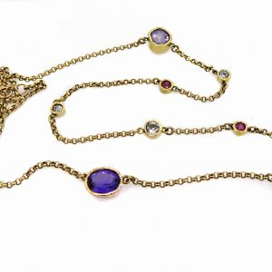 Necklace with diamonds rubies and amethysts