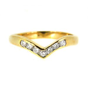 Shaped 9ct yellow gold wedding ring with diamonds. £550.00