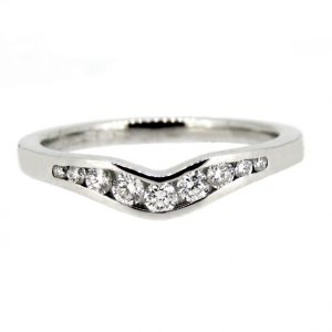 18ct shaped wedding ring.  £1160.00